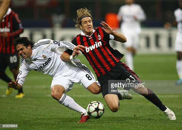 Kaka of Real Madrid is tackled by Massimo Ambrosini of AC Milan during the UEFA Champions League Group C match between AC Milan and Real Madrid at...