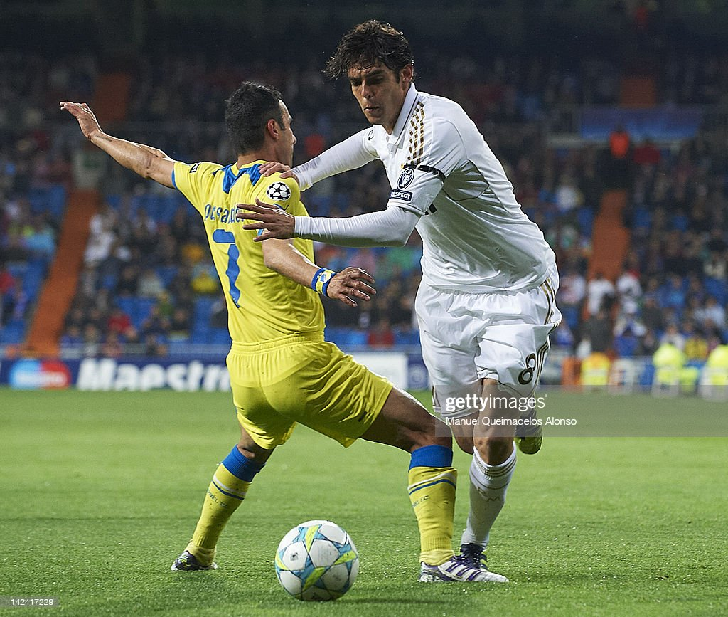 Kaka (R) of Real Madrid is tackled by Savvas Poursaitides of APOEL FC during the UEFA Champions League quarter-final second leg match between Real Madrid and APOEL FC at Bernabeu on April 4, 2012 in Madrid, Spain.