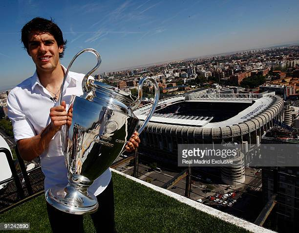 Kaka of Real Madrid poses with a European Cup and the Santiago Bernabeu Stadium during a interview at Torre Europa on September 29 2009 in Madrid...