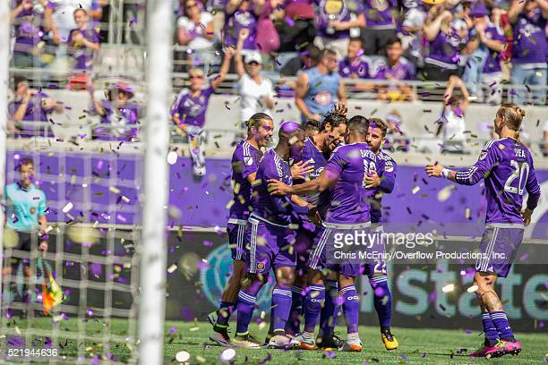 Kaka of the Orlando City Lions celebrates with Brek Shea Julio Baptista after scoring a penalty kick against the New England Revolution April 17 2016...