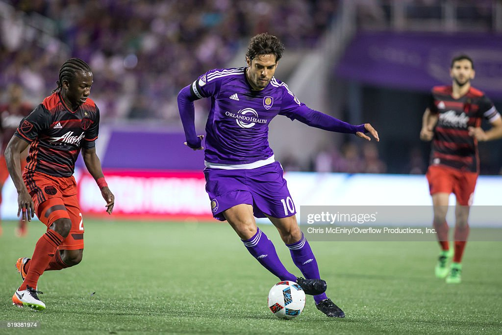 Kaka #10 of the Orlando City SC takes on Diego Chara #21 of the Portland Timbers at the Citrus Bowl on April 3, 2016 in Orlando, Florida.