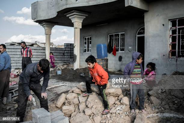 Kaka'i family who have recently returned to rebuild their home in Gazakan village in the Nineveh plains of Iraq Families have recently returned to...