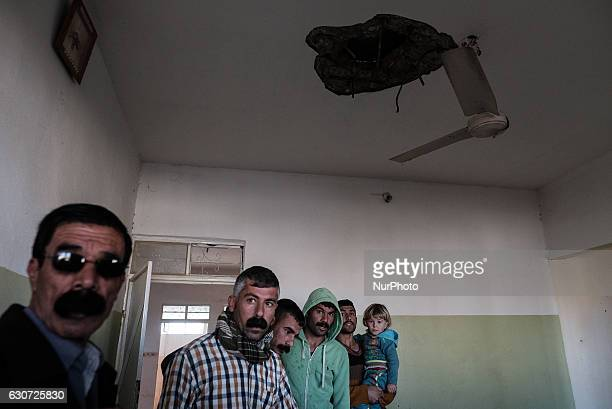 Kakais inside destroyed house taken from ISIL in Tel Laban/ Gazakan on 30 December 2016 The Kakai Kurds are returning to their homes as Mosul...
