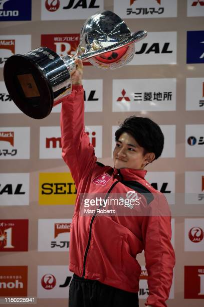 Kakeru Tanigawa of Japan holds the NHK trophy aloft during day two of the Artistic Gymnastics NHK Trophy at Musashino Forest Sport Plaza on May 19,...