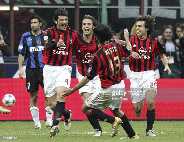 Kakha Kaladze of AC Milan celebrates with team mates acfetr scoring the winning goal during the Serie A match between AC Milan and Inter Milan at the...