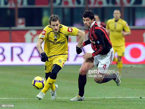 Kakha Kaladze of AC Milan competes for the ball with Antonio Floro Flores of Udinese Calcio during the Tim Cup match between Milan and Udinese at...