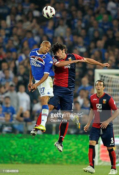 Kakha Kaladze of Genoa CFC and Jonathan Biabiany of UC Sampdoria compete for the ball during the Serie A match between Genoa CFC and UC Sampdoria at...