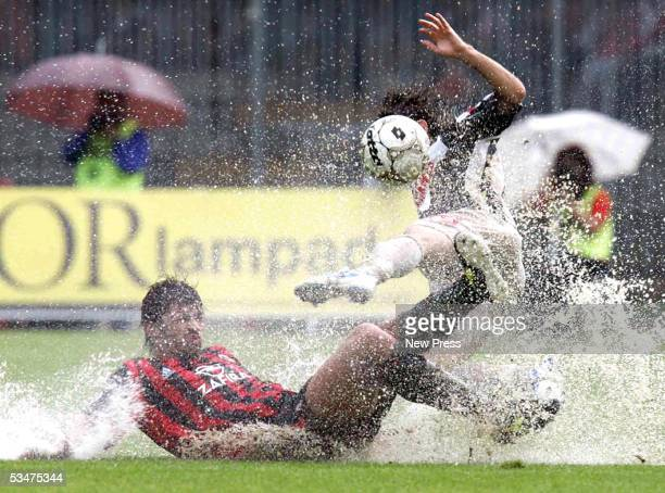 Kakha Kaladze of Milan slides for the ball during the Serie A match between Ascoli and AC Milan on August 28 2005 in Ascoli Italy