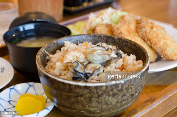 kaki meshi teishoku (set menu featuring steamed oysters on rice) - takuan stock photos and pictures
