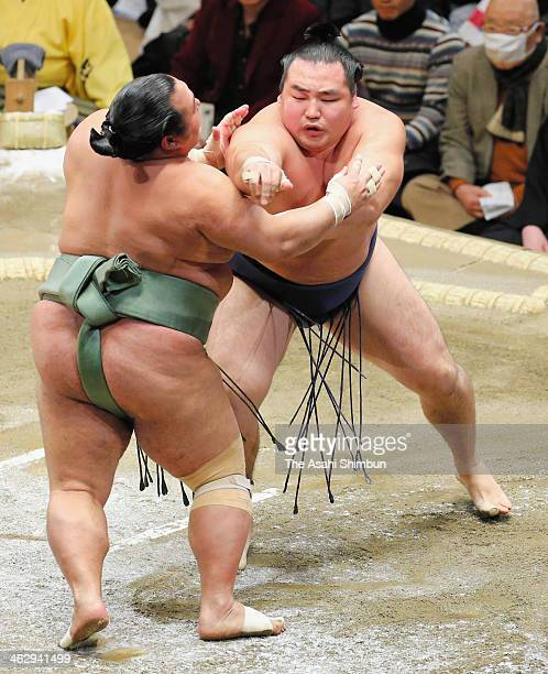 Kakuryu attacks Toyonoshima on day four of the Grand Sumo New Year Tournamnet at Ryogoku Kokugikan on January 15 2014 in Tokyo Japan