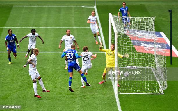 Kal Naismith of Wigan Athletic scores his team's first goal during the Sky Bet Championship match between Wigan Athletic and Hull City at DW Stadium...