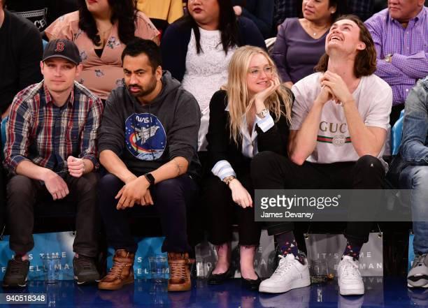 Kal Penn and Dakota Fanning attend New York Knicks vs Detroit Pistons game at Madison Square Garden on March 31 2018 in New York City