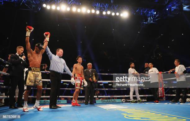 Kal Yafai celebrates as he is awarded victory after his WBA SuperFlyweight Championship contest against Sho Ishida at Principality Stadium on October...
