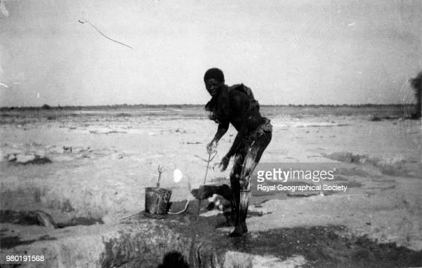 Kalahari drawing water from a well 1899