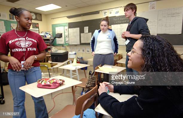 Kalamazoo Central High School seniors Shanitra Waymire, from left, Rachel Brown, Jeremy Liggett and Emily Robinson, get ready for an Advanced...