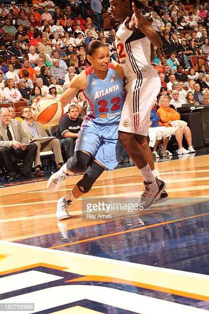 Kalana Greene of the Connecticut Sun defends against Armintie Price of the Atlanta Dream on September 23 2012 at the Mohegan Sun Arena in Uncasville...