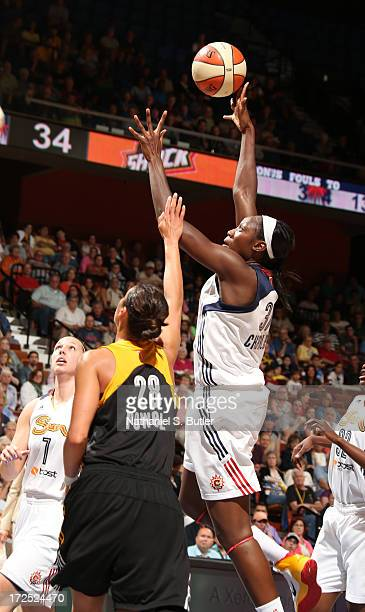 Kalana Greene of the Connecticut Sun shoots over Nicole Powell of the Tulsa Shock during a game on July 2 2013 at the Mohegan Sun Arena in Uncasville...