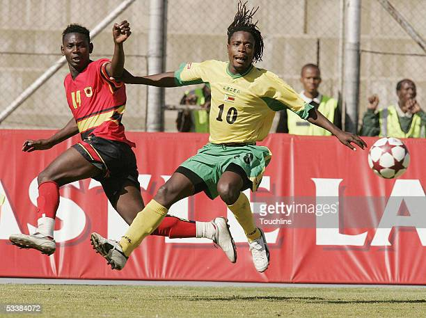 Kalanga of Angola clashes with Gift Lungu of Zimbabwe during the 2005 COSAFA Cup semifinal match between Zimbabwe and Angola at the Mmabatho Stadium...