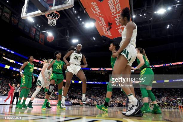 Kalani Brown and DiDi Richards of the Baylor Lady Bears celebrate the basket against the Oregon Ducks during the fourth quarter in the semifinals of...