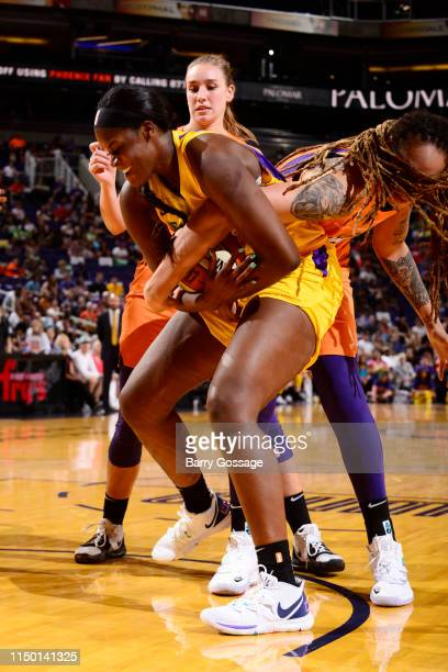 Kalani Brown of Los Angeles Sparks handles the ball against the Phoenix Mercury on June 14 2019 at the Talking Stick Resort Arena in Phoenix Arizona...