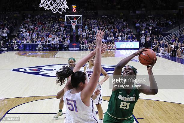 Kalani Brown of the Baylor Bears attempts to shoot past Natalie Butler of the UConn Huskies during the UConn Huskies Vs Baylor Bears NCAA Women's...
