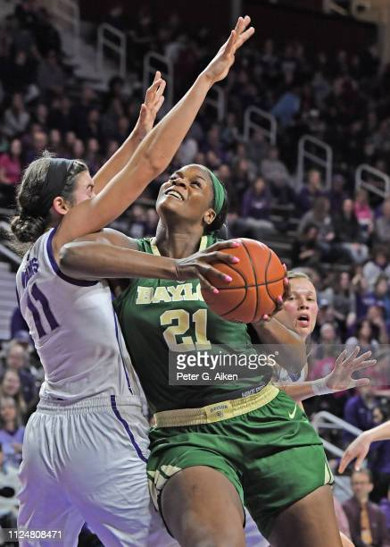 Kalani Brown of the Baylor Bears goes to the basket against Peyton Williams of the Kansas State Wildcats during the first half on February 13 2019 at...