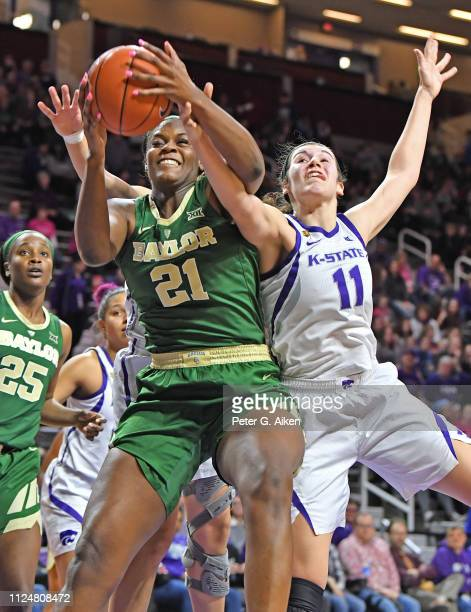 Kalani Brown of the Baylor Bears grabs a rebound against Peyton Williams of the Kansas State Wildcats during the first half on February 13 2019 at...