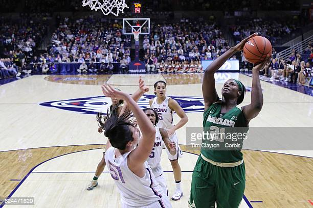 Kalani Brown of the Baylor Bears shoots past Natalie Butler of the UConn Huskies during the UConn Huskies Vs Baylor Bears NCAA Women's Basketball...