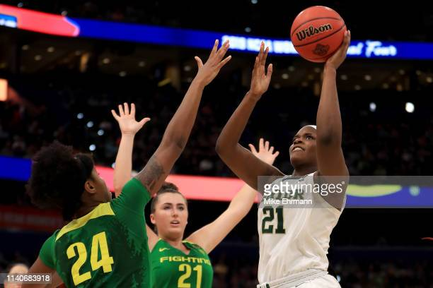 Kalani Brown of the Baylor Lady Bears attempts a shot against Ruthy Hebard and Erin Boley of the Oregon Ducks during the fourth quarter in the...
