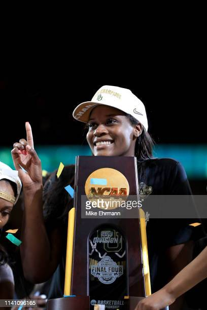 Kalani Brown of the Baylor Lady Bears celebrates with the trophy after the 8281 win over the Notre Dame Fighting Irish to win the championship game...