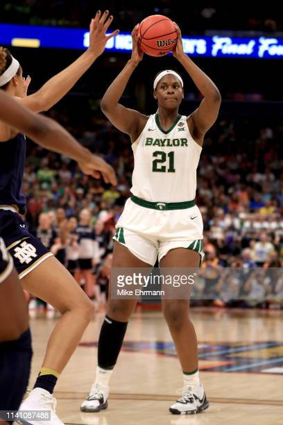 Kalani Brown of the Baylor Lady Bears handles the ball on offense against the Notre Dame Fighting Irish during the third quarter in the championship...