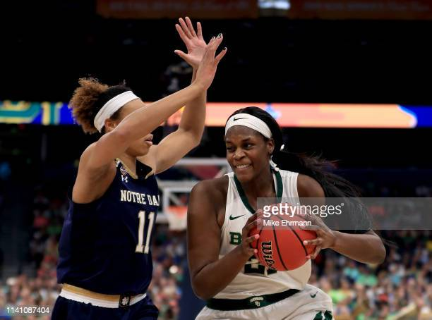 Kalani Brown of the Baylor Lady Bears is defended by Brianna Turner of the Notre Dame Fighting Irish during the third quarter in the championship...