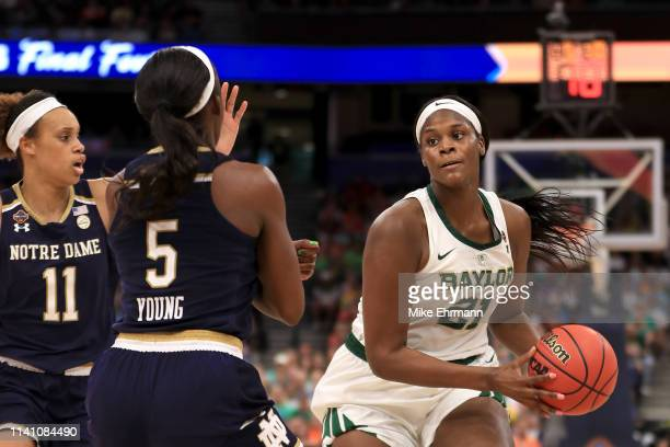 Kalani Brown of the Baylor Lady Bears is defended by Jackie Young of the Notre Dame Fighting Irish during the third quarter in the championship game...