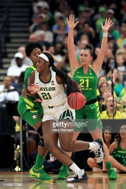 Kalani Brown of the Baylor Lady Bears is defended by Ruthy Hebard and Erin Boley of the Oregon Ducks during the first quarter in the semifinals of...