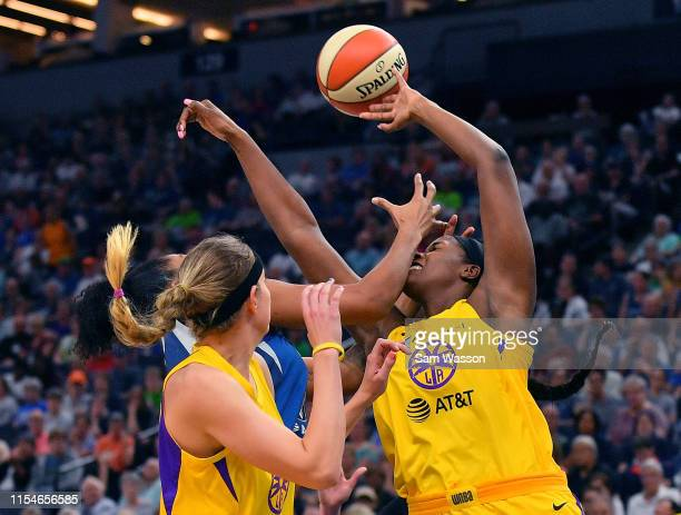 Kalani Brown of the Los Angeles Sparks battles for a rebound against Damiris Dantas of the Minnesota Lynx during their game at Target Center on June...