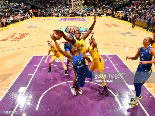 Kalani Brown of the Los Angeles Sparks blocks a shot by Kaela Davis of Dallas Wings on July 18 2019 at the Staples Center in Los Angeles California...