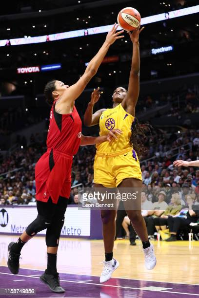 Kalani Brown of the Los Angeles Sparks handles the ball against Liz Cambage of the Las Vegas Aces during a WNBA basketball game at Staples Center on...