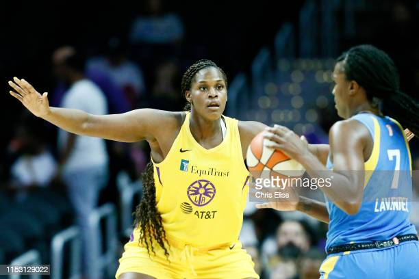 Kalani Brown of the Los Angeles Sparks plays defense against Jantel Lavender of the Chicago Sky on June 30 2019 at the Staples Center in Los Angeles...