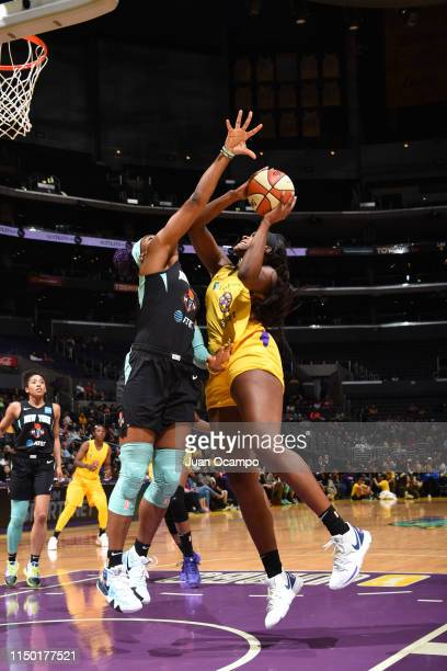 Kalani Brown of the Los Angeles Sparks shoots the contested shot against the New York Liberty on June 15 2019 at the Staples Center in Los Angeles...