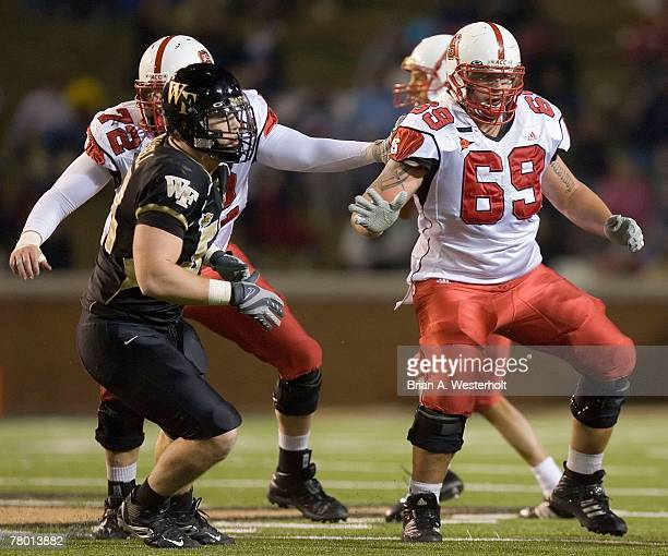 Kalani Heppe of the North Carolina State Wolfpack provides pass protection versus the Wake Forest Demon Deacon defenders at BB&T Field November 17,...