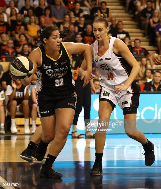 Kalani Purcell of the Melbourne Boomers is pressured by Darcee Garbin of the Townsville Fire during game two of the WNBL Grand Final series between...