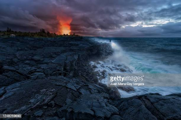 the kilauea volcano and the pacific ocean fight for the power of the island of hawaii - kalapana beach (hawaii, usa) - category:census-designated_places_in_honolulu_county,_hawaii stock pictures, royalty-free photos & images