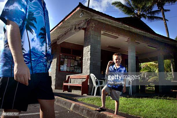 Kalapana Hawaii – Felix Rodriguez left of Seattle Wa and his son Samson wear matching shirts to Verna s Drive–In on the Big Island of Hawaii Verna's...