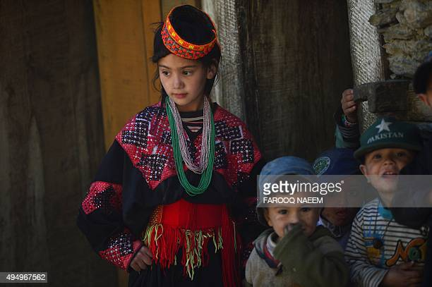 Kalash children play outside their home in Bumburate village of Kalash valley on October 30 2015 The Kalash considered the only surviving animist...