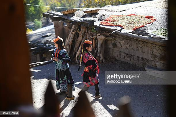 Kalash children play outside their home in Bumburate village of Kalash valley on October 30, 2015. The Kalash, considered the only surviving animist...