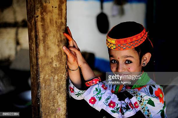 Kalash girl poses for a photo with traditional clothes at Bumburet, largest valley of Kalasha Desh in Chitral District of Khyber Pakhtunkhwa,...