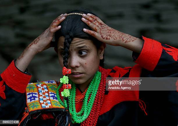 Kalash girl poses for a photo with traditional clothes at Bumburet largest valley of Kalasha Desh in Chitral District of Khyber Pakhtunkhwa Pakistan...