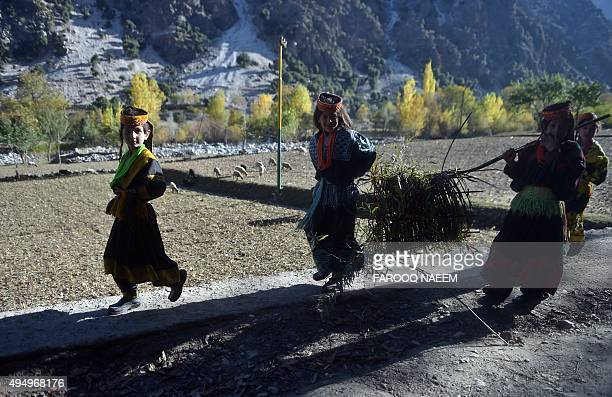 Kalash girls play in Bumburate on October 30, 2015. Kalash, considered as the only surviving animist tribe of Pakistan was badly affected by two...