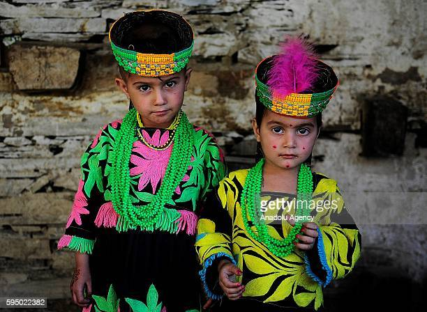 Kalash girls pose for a photo with traditional clothes at Bumburet, largest valley of Kalasha Desh in Chitral District of Khyber Pakhtunkhwa,...
