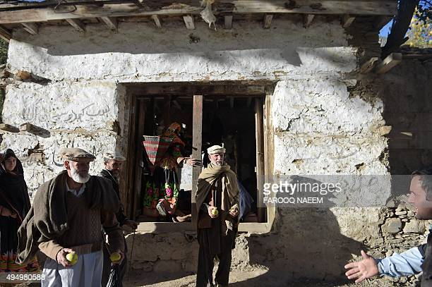 Kalash peoples gather outside a shop in the Bumburate village of the Kalash valley on October 30, 2015. Kalash, considered the only surviving animist...